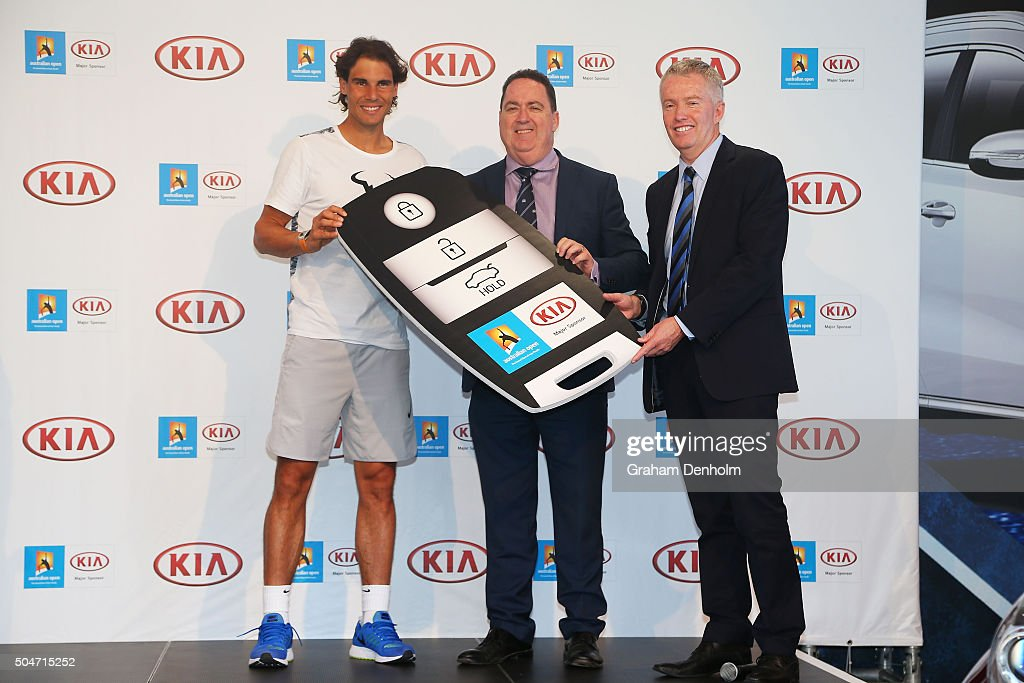 Rafael Nadal of Spain Kia COO Damien Meredith and Australian Open Tournament Director Craig Tiley pose during a Kia Key handover ceremony at Garden...