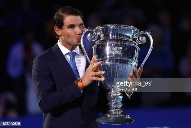 Rafael Nadal of Spain kisses the Emirates ATP year end World Number One trophy after a presentation to him on the first day of the Nitto ATP World...