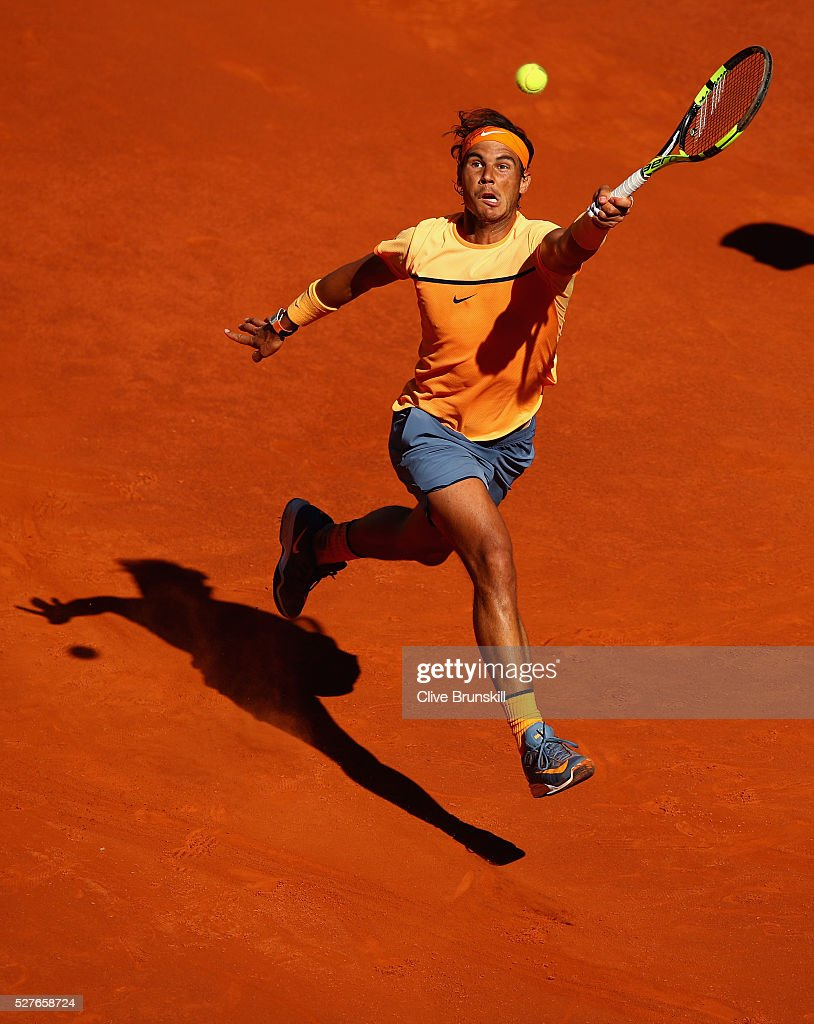 <a gi-track='captionPersonalityLinkClicked' href=/galleries/search?phrase=Rafael+Nadal&family=editorial&specificpeople=194996 ng-click='$event.stopPropagation()'>Rafael Nadal</a> of Spain leaps into the air to play a forehand against Andrey Kuznetsov of Russia in their second round match during day four of the Mutua Madrid Open tennis tournament at the Caja Magica on May 03, 2016 in Madrid,Spain.