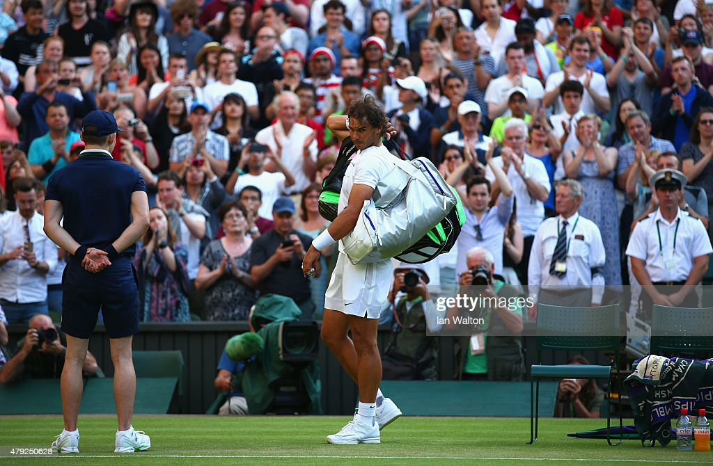 Rafael Nadal of Spain leaves the court dejected after losing his Gentlemens Singles Second Round match against Dustin Brown of Germany during day four of the Wimbledon Lawn Tennis Championships at the All England Lawn Tennis and Croquet Club on July 2, 2015 in London, England.