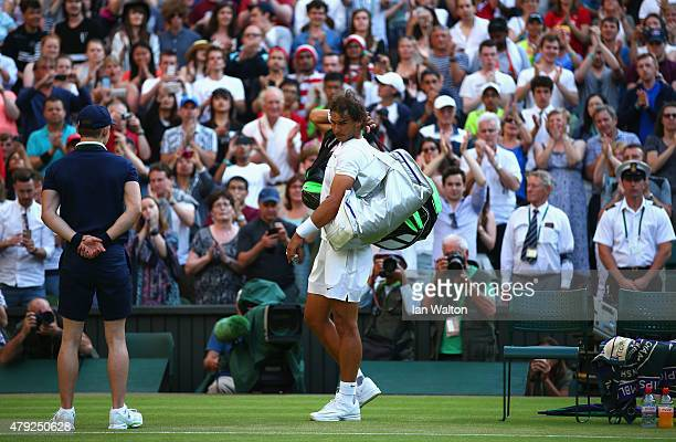 Rafael Nadal of Spain leaves the court dejected after losing his Gentlemens Singles Second Round match against Dustin Brown of Germany during day...