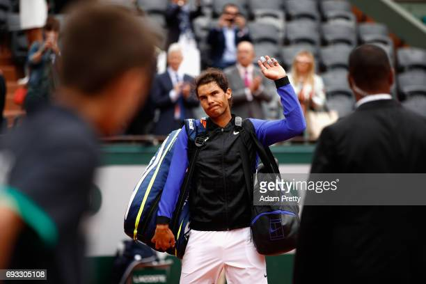 Rafael Nadal of Spain leaves the court following victory in the mens singles quarter finals match against Pablo Carreno Busta of Spain on day eleven...