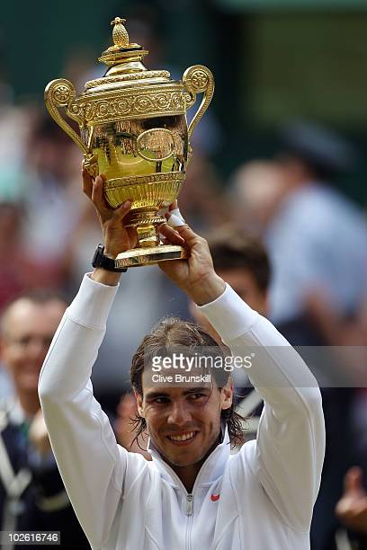 Rafael Nadal of Spain lifts the Championship trophy after winning the Men's Singles Final match against Tomas Berdych of Czech Republic on Day...
