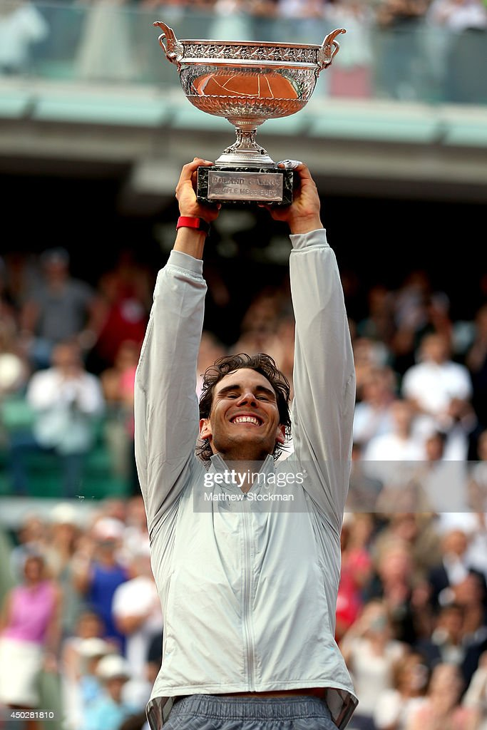 Rafael Nadal of Spain lifts the Coupe de Mousquetaires after victory in his men's singles final match against Novak Djokovic of Serbia on day fifteen of the French Open at Roland Garros on June 8, 2014 in Paris, France.