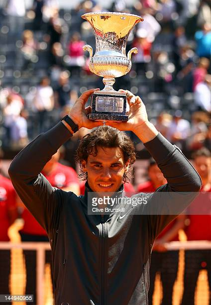 Rafael Nadal of Spain lifts the trophy after defeating Novak Djokovic of Serbia in their final match during day ten of the Internazionali BNL...