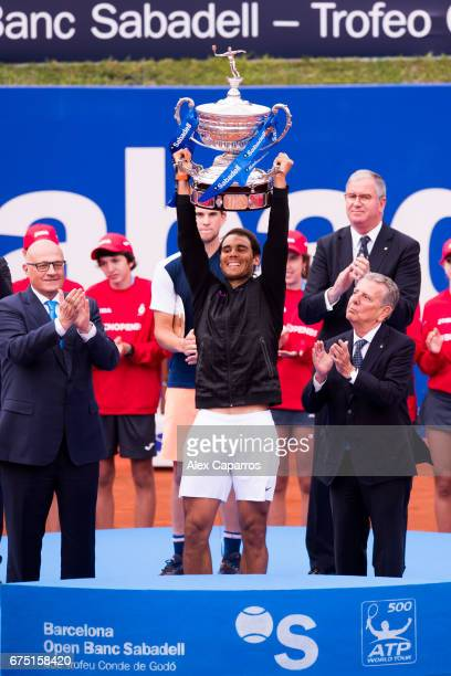 Rafael Nadal of Spain lifts the trophy after his victory against Dominic Thiem of Austria in their final match on day seven of the Barcelona Open...