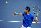 Rafael Nadal of Spain lines up a return shot against Novak Djokovic of Serbia during the Men's Final on Day Fifteen of the 2011 US Open at the USTA...