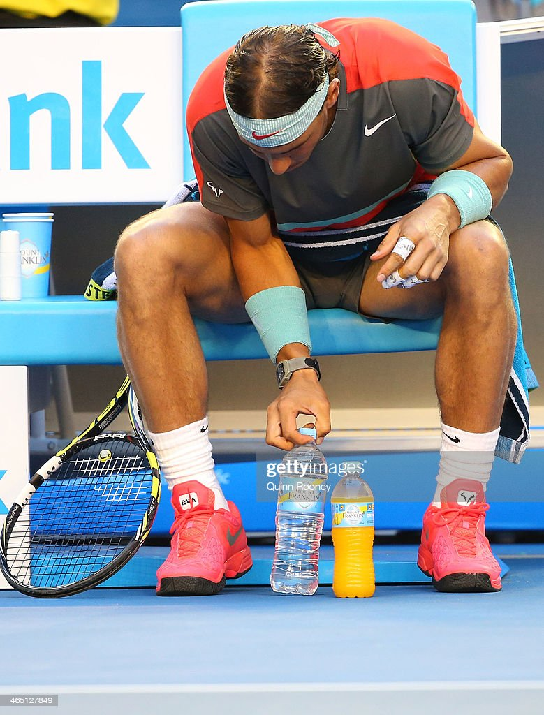 Rafael Nadal of Spain lines up his drink bottles ahead of his men's final match against Stanislas Wawrinka of Switzerland during day 14 of the 2014 Australian Open at Melbourne Park on January 26, 2014 in Melbourne, Australia.
