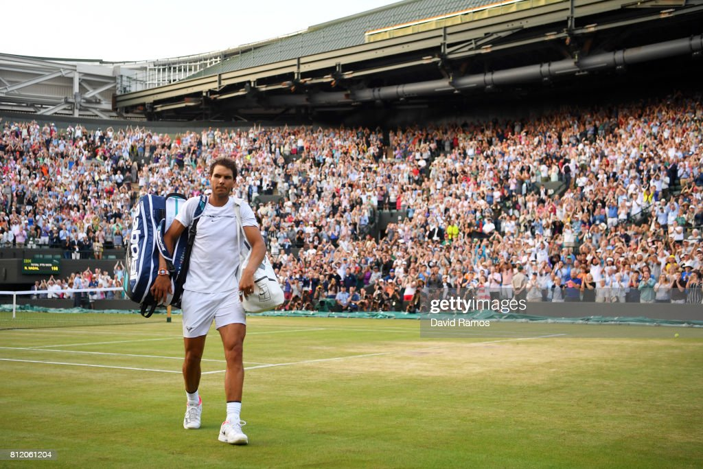 Rafael Nadal of Spain looks dejected in defeat after the Gentlemen's Singles fourth round match against Gilles Muller of Luxembourg on day seven of the Wimbledon Lawn Tennis Championships at the All England Lawn Tennis and Croquet Club on July 10, 2017 in London, England.