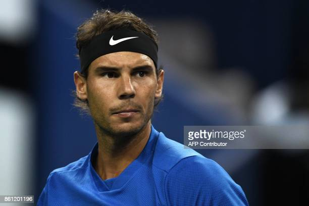 Rafael Nadal of Spain looks on as he warms up before his men's semifinals singles match against Marin Cilic of Croatia at the Shanghai Masters tennis...