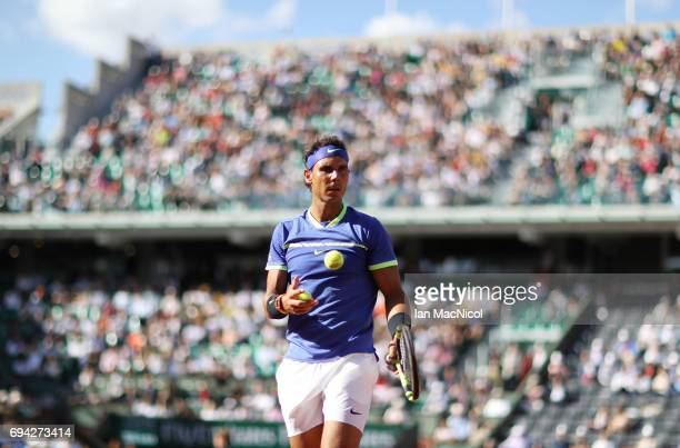 Rafael Nadal of Spain looks on during his semifinal match with Dominic Thiem of Austria on day thirteen at Roland Garros on June 9 2017 in Paris...