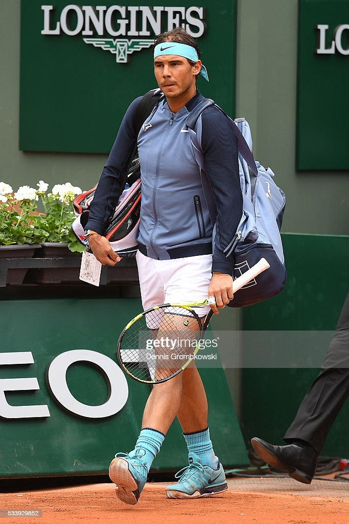 <a gi-track='captionPersonalityLinkClicked' href=/galleries/search?phrase=Rafael+Nadal&family=editorial&specificpeople=194996 ng-click='$event.stopPropagation()'>Rafael Nadal</a> of Spain makes his way onto the court prior to the Men's Singles first round match against Sam Groth of Australia on day three of the 2016 French Open at Roland Garros on May 24, 2016 in Paris, France.