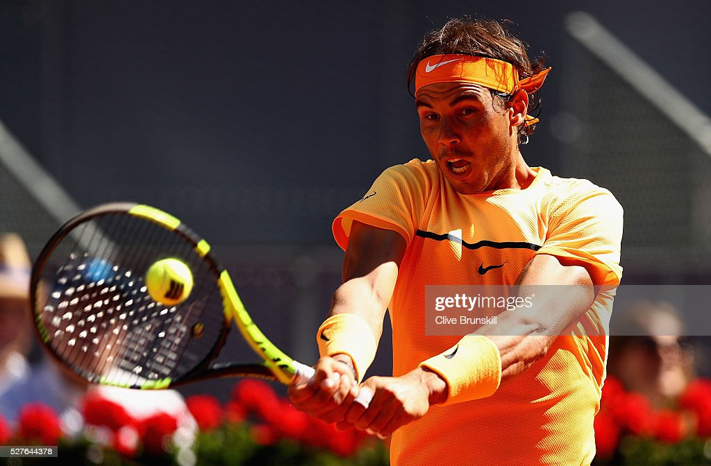Rafael Nadal of Spain plays a backhand against Andrey Kuznetsov of Russia in their second round match during day four of the Mutua Madrid Open tennis tournament at the Caja Magica on May 03, 2016 in Madrid,Spain.