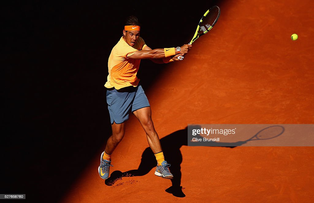 <a gi-track='captionPersonalityLinkClicked' href=/galleries/search?phrase=Rafael+Nadal&family=editorial&specificpeople=194996 ng-click='$event.stopPropagation()'>Rafael Nadal</a> of Spain plays a backhand against Andrey Kuznetsov of Russia in their second round match during day four of the Mutua Madrid Open tennis tournament at the Caja Magica on May 03, 2016 in Madrid,Spain.