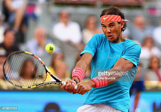 Rafael Nadal of Spain plays a backhand against Andy Murray of Great Britain in the mens final during day nine of the Mutua Madrid Open tennis...