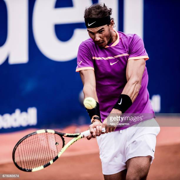 Rafael Nadal of Spain plays a backhand against Horacio Zeballos of Argentina in their semifinal match on day six of the Barcelona Open Banc Sabadell...