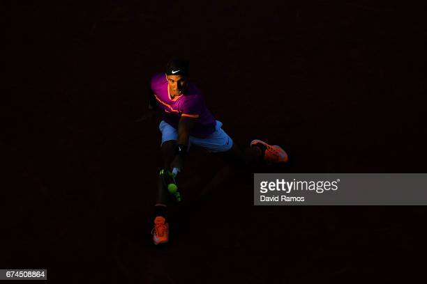 Rafael Nadal of Spain plays a backhand against Hyeon Chung of South Korea on day five of the Barcelona Open Banc Sabadell in the quarterfinal on day...