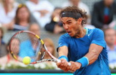 Rafael Nadal of Spain plays a backhand against Kei Nishikori of Japan in their final match during day nine of the Mutua Madrid Open tennis tournament...