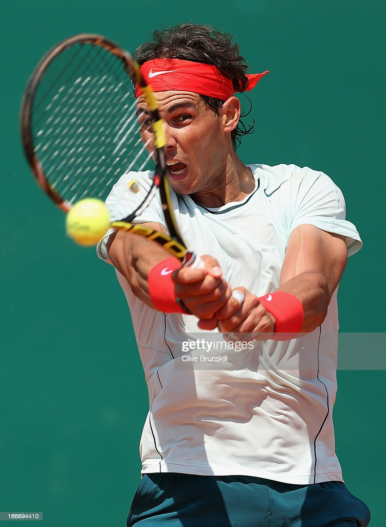 <a gi-track='captionPersonalityLinkClicked' href=/galleries/search?phrase=Rafael+Nadal&family=editorial&specificpeople=194996 ng-click='$event.stopPropagation()'>Rafael Nadal</a> of Spain plays a backhand against Philipp Kohlschreiber of Germany in their third round match during day five of the ATP Monte Carlo Masters,at Monte-Carlo Sporting Club on April 18, 2013 in Monte-Carlo, Monaco.