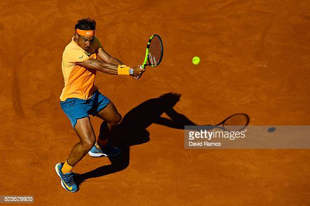 Rafael Nadal of Spain plays a backhand against Philipp Kohlschreiber of Germany during day six of the Barcelona Open Banc Sabadell at the Real Club...