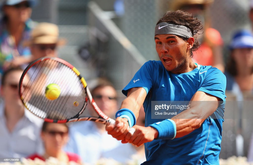 <a gi-track='captionPersonalityLinkClicked' href=/galleries/search?phrase=Rafael+Nadal&family=editorial&specificpeople=194996 ng-click='$event.stopPropagation()'>Rafael Nadal</a> of Spain plays a backhand against Roberto Bautista Agut of Spain in their semi final match during day eight of the Mutua Madrid Open tennis tournament at the Caja Magica on May 10, 2014 in Madrid, Spain.