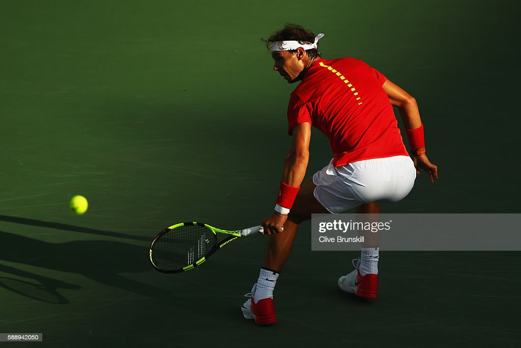 Rafael Nadal of Spain plays a backhand against Thomaz Bellucci of Brazil in the Men's Singles Quarterfinal on Day 7 of the Rio 2016 Olympic Games at the Olympic Tennis Centre on August 12, 2016 in Rio de Janeiro, Brazil.