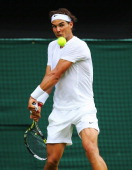 Rafael Nadal of Spain plays a backhand during his Gentlemen's Singles first round match against Martin Klizan of Slovakia on day two of the Wimbledon...