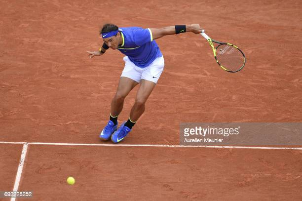 Rafael Nadal of Spain plays a Backhand during his Men's single match against Roberto Bautista Agut of Spain on day eight of the 2017 French Open at...