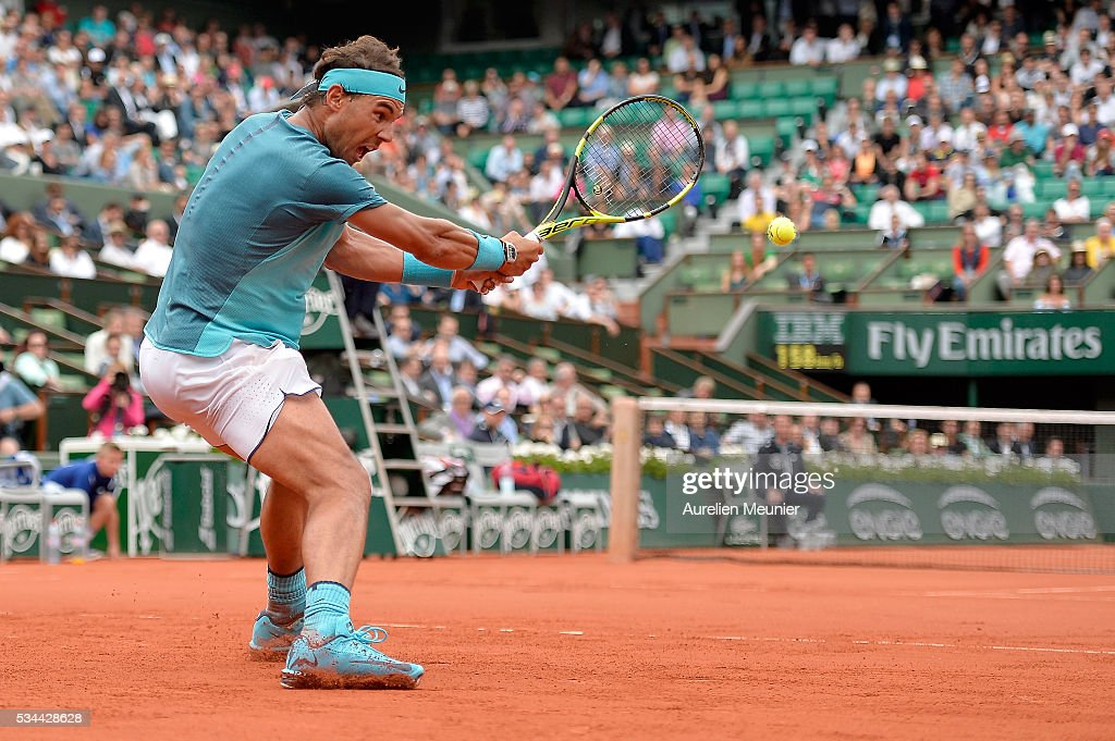 <a gi-track='captionPersonalityLinkClicked' href=/galleries/search?phrase=Rafael+Nadal&family=editorial&specificpeople=194996 ng-click='$event.stopPropagation()'>Rafael Nadal</a> of Spain plays a backhand during his men's single second round match against Facundo Bagnis of Argentina on day five of the 2016 French Open at Roland Garros on May 26, 2016 in Paris, France.