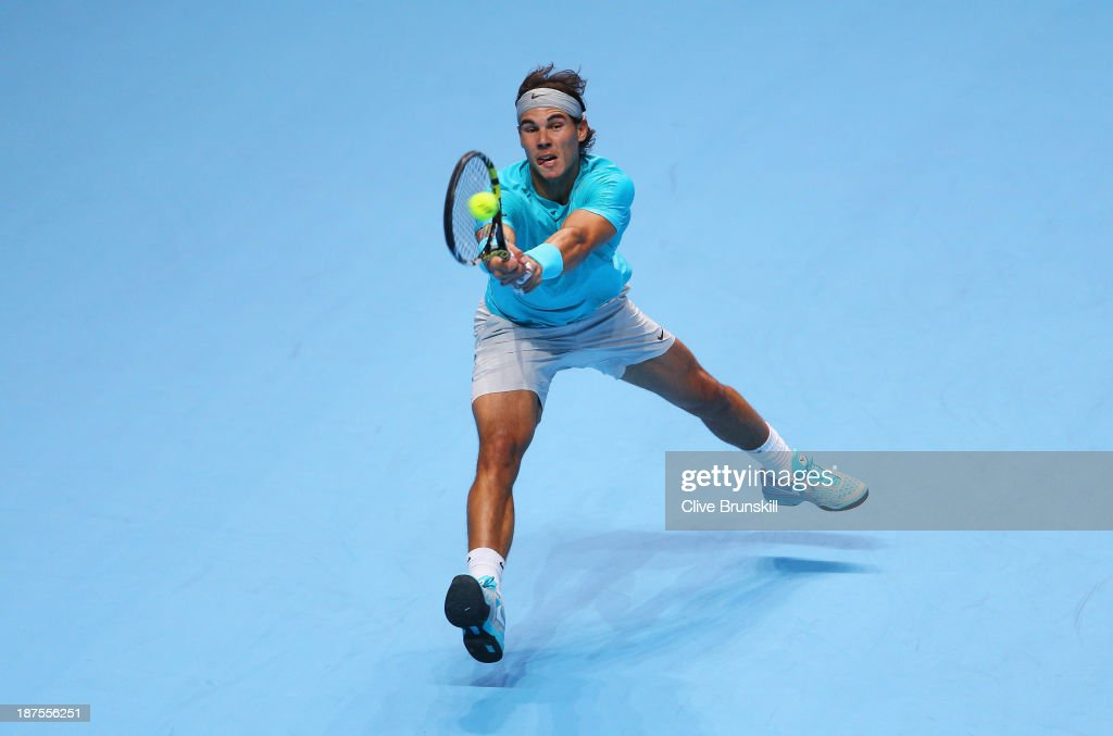 Rafael Nadal of Spain plays a backhand during his men's singles semi-final match against Roger Federer of Switzerland during day seven of the Barclays ATP World Tour Finals at O2 Arena on November 10, 2013 in London, England.