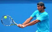 Rafael Nadal of Spain plays a backhand during practice ahead of the 2014 Australian Open at Melbourne Park on January 12 2014 in Melbourne Australia