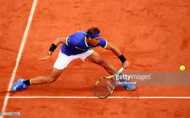 Rafael Nadal of Spain plays a backhand during the mens singles final match against Stan Wawrinka of Switzerland on day fifteen of the 2017 French...