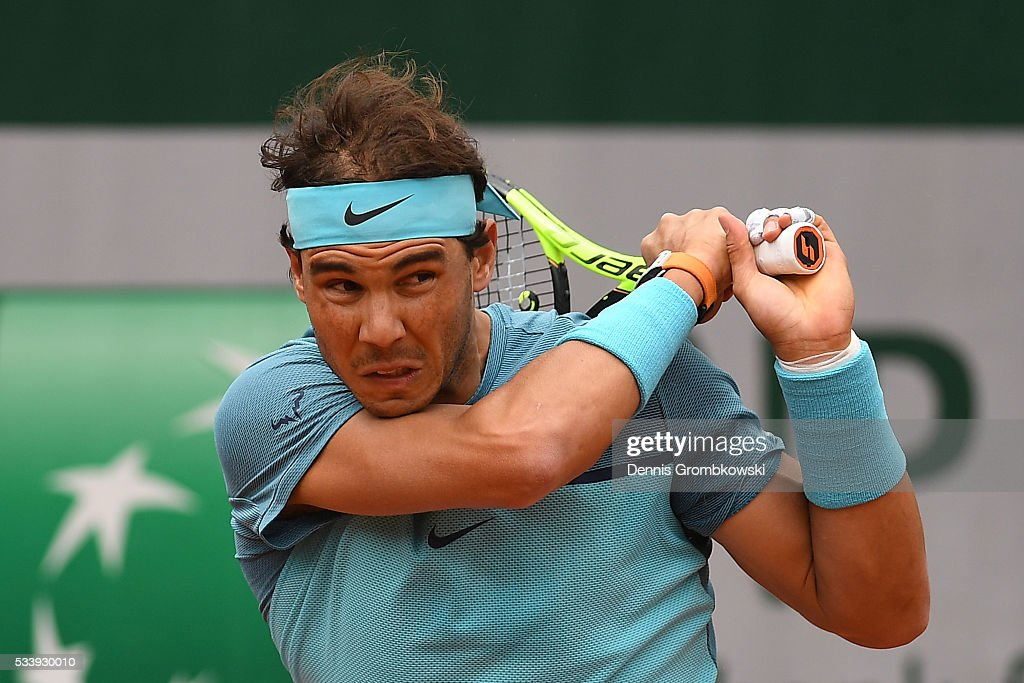 <a gi-track='captionPersonalityLinkClicked' href=/galleries/search?phrase=Rafael+Nadal&family=editorial&specificpeople=194996 ng-click='$event.stopPropagation()'>Rafael Nadal</a> of Spain plays a backhand during the Men's Singles first round match against Sam Groth of Australia on day three of the 2016 French Open at Roland Garros on May 24, 2016 in Paris, France.