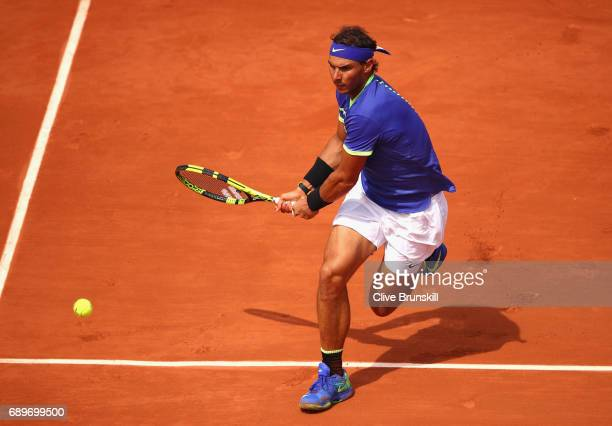 Rafael Nadal of Spain plays a backhand during the mens singles first round match against Benoit Paire of France on day two of the 2017 French Open at...
