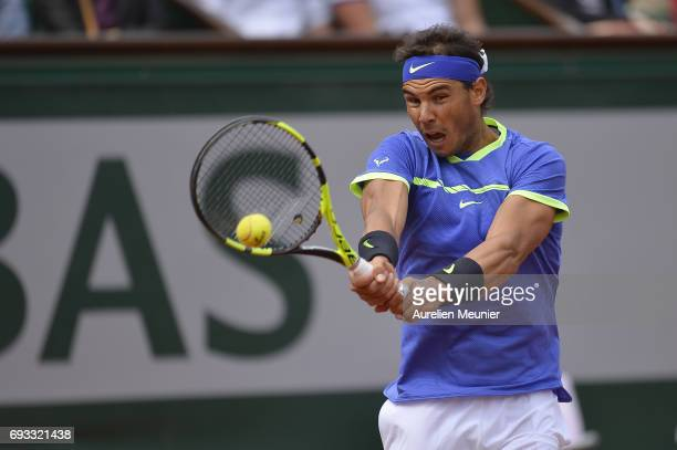 Rafael Nadal of Spain plays a backhand during the men's singles quarterfinal match against Pablo Carreno Busta of Spain on day eleven of the 2017...