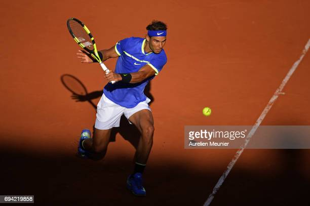 Rafael Nadal of Spain plays a backhand during the men's singles semi finals match against Dominic Thiem of Austria on day thirteen of the 2017 French...