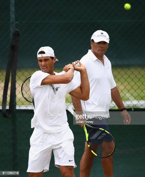 Rafael Nadal of Spain plays a backhand in a training session with coach and uncle Toni Nadal at Wimbledon on July 9 2017 in London England