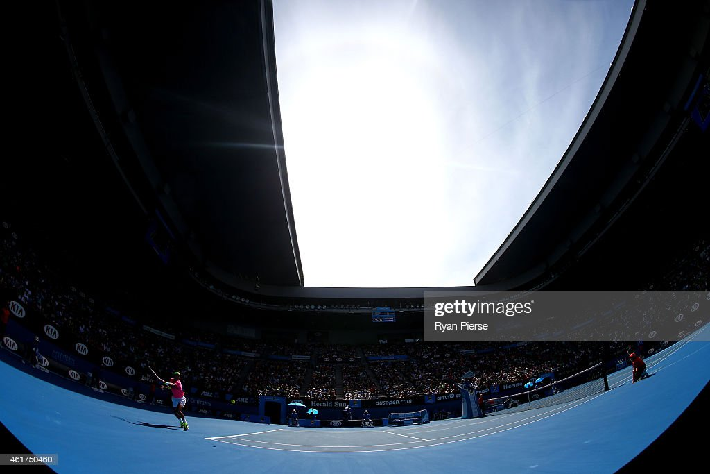 <a gi-track='captionPersonalityLinkClicked' href=/galleries/search?phrase=Rafael+Nadal&family=editorial&specificpeople=194996 ng-click='$event.stopPropagation()'>Rafael Nadal</a> of Spain plays a backhand in his first round match against <a gi-track='captionPersonalityLinkClicked' href=/galleries/search?phrase=Mikhail+Youzhny&family=editorial&specificpeople=171709 ng-click='$event.stopPropagation()'>Mikhail Youzhny</a> of Russia during day one of the 2015 Australian Open at Melbourne Park on January 19, 2015 in Melbourne, Australia.