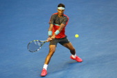 Rafael Nadal of Spain plays a backhand in his his men's final match against Stanislas Wawrinka of Switzerland during day 14 of the 2014 Australian...