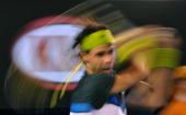 Rafael Nadal of Spain plays a backhand stroke during his men's singles semifinal match against compatriot Fernando Verdasco at the Australian Open...