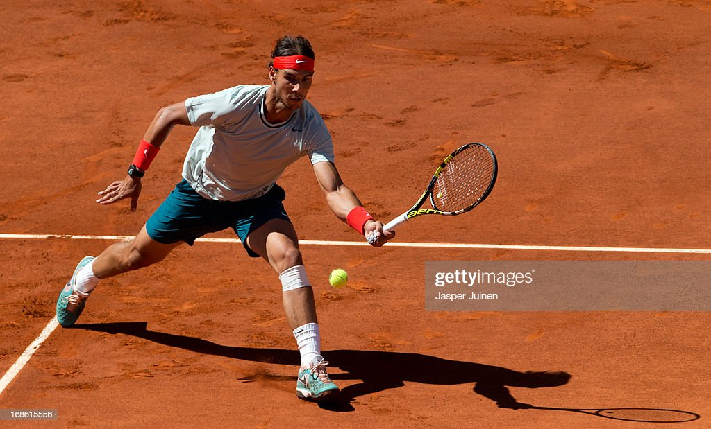 Rafael Nadal of Spain plays a backhand to Stanislas Wawrinka of Switzerland during the final match on day nine of the Mutua Madrid Open tennis tournament at the Caja Magica on May 12, 2013 in Madrid, Spain.