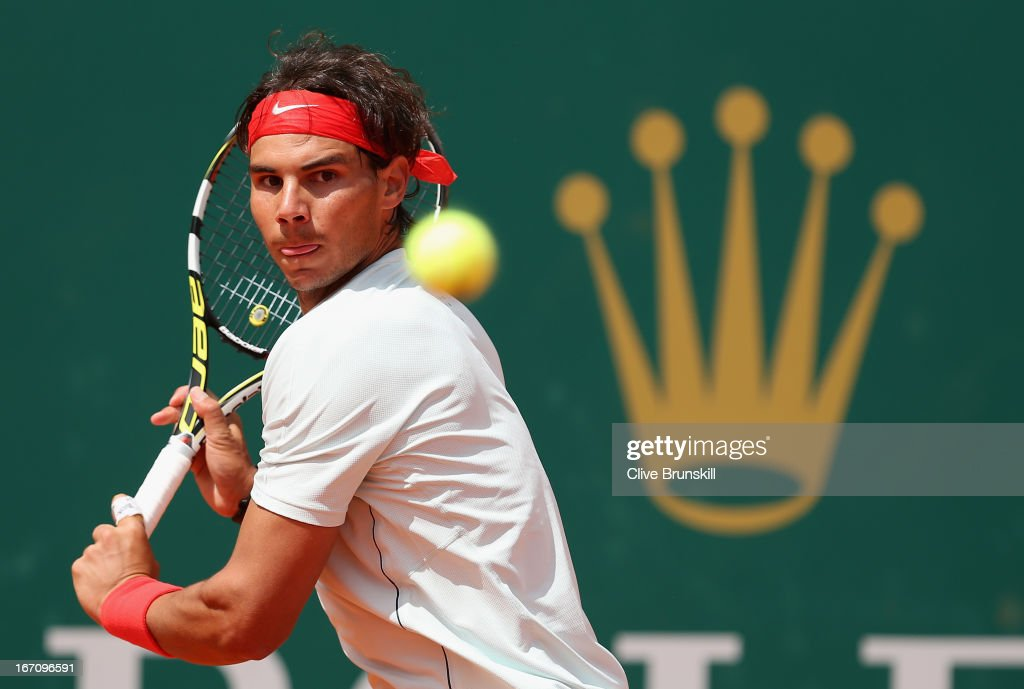 <a gi-track='captionPersonalityLinkClicked' href=/galleries/search?phrase=Rafael+Nadal&family=editorial&specificpeople=194996 ng-click='$event.stopPropagation()'>Rafael Nadal</a> of Spain plays a backhand volley against Jo-Wilfried Tsonga of France in their semi final match during day seven of the ATP Monte Carlo Masters,at Monte-Carlo Sporting Club on April 20, 2013 in Monte-Carlo, Monaco.