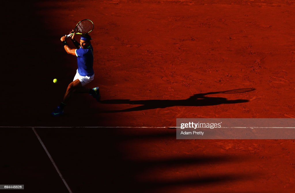 Rafael Nadal of Spain plays a backhands during the mens singles semi-final match against Dominic Thiem of Austria on day thirteen of the 2017 French Open at Roland Garros on June 9, 2017 in Paris, France.