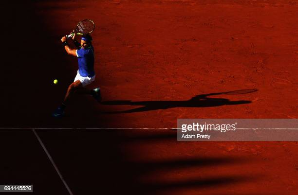 Rafael Nadal of Spain plays a backhands during the mens singles semifinal match against Dominic Thiem of Austria on day thirteen of the 2017 French...