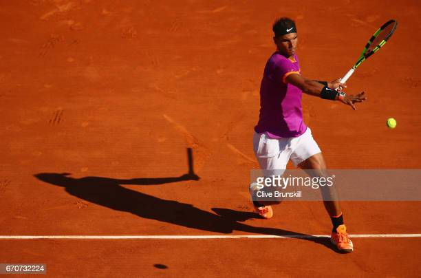 Rafael Nadal of Spain plays a forehand against Alexander Zverev of Germany in his third round match on day five of the Monte Carlo Rolex Masters at...