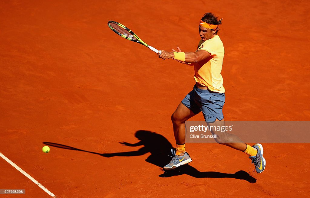 Rafael Nadal of Spain plays a forehand against Andrey Kuznetsov of Russia in their second round match during day four of the Mutua Madrid Open tennis tournament at the Caja Magica on May 03, 2016 in Madrid,Spain.