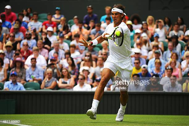 Rafael Nadal of Spain plays a forehand during his Gentlemen's Singles first round match against Martin Klizan of Slovakia on day two of the Wimbledon...