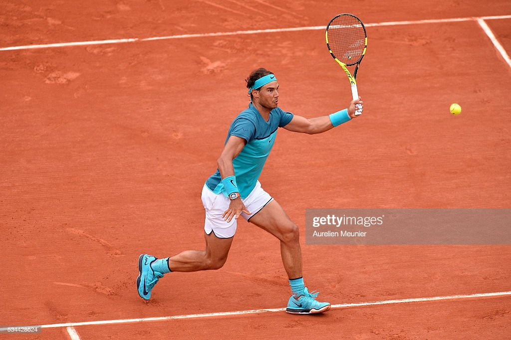 <a gi-track='captionPersonalityLinkClicked' href=/galleries/search?phrase=Rafael+Nadal&family=editorial&specificpeople=194996 ng-click='$event.stopPropagation()'>Rafael Nadal</a> of Spain plays a forehand during his men's single second round match against Facundo Bagnis of Argentina on day five of the 2016 French Open at Roland Garros on May 26, 2016 in Paris, France.