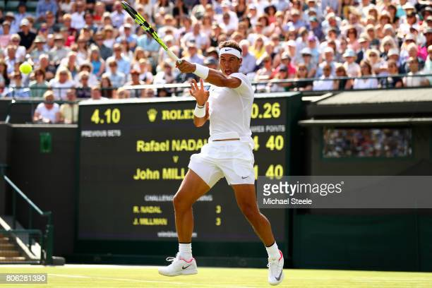 Rafael Nadal of Spain plays a forehand during the Gentlemen's Singles first round match on day one of the Wimbledon Lawn Tennis Championships at the...