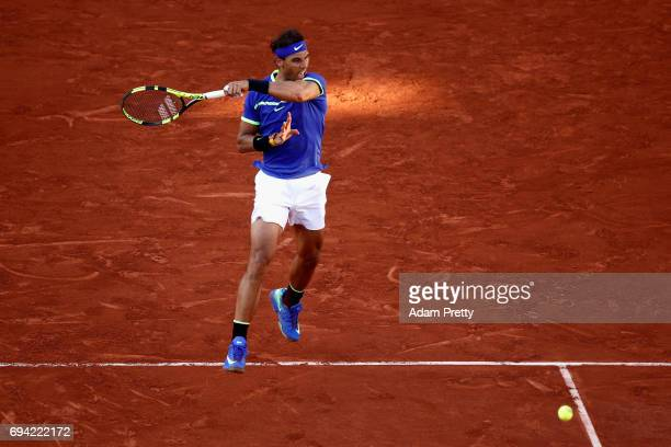 Rafael Nadal of Spain plays a forehand during the mens singles semifinal match against Dominic Thiem of Austria on day thirteen of the 2017 French...